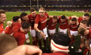 The Wales captain Alun Wyn Jones leads a group huddle at the end of the win over England in Cardiff.