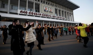 People dance near the Pyongyang Indoor Stadium on Friday to celebrate the nuclear test.