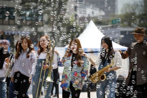 A band performs at an event celebrating the summit in Seoul Square in Seoul, South Korea