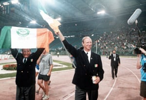 In 1990 Charlton led the Republic of Ireland to their first World Cup, reaching the quarter-final where they lost 1-0 to Italy. Charlton and assistant Maurice Setters hold aloft the Irish flag as they wave farewell to the crowd after the match.