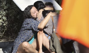 Survivors embrace each other near the scene of the attack in Nice.