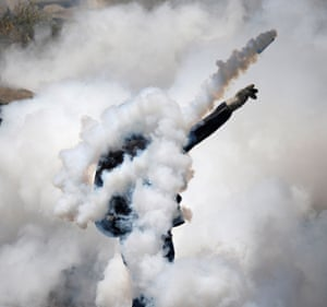 A demonstrator is engulfed in teargas