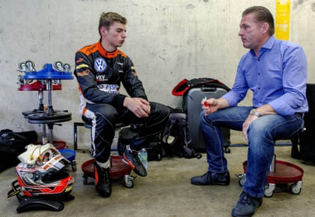 A 16-year-old Max Verstappen 16, speaks with his father Jos Verstappen (R) prior to the a Formula 3 race in 2014