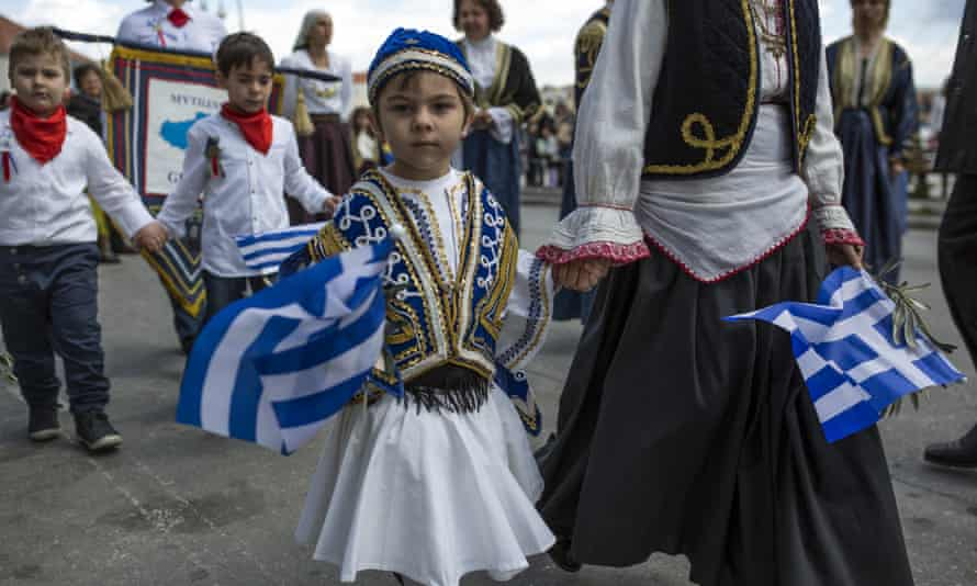 Schoolchildren take part in an Independence Day parade in Mytilene, Greece.
