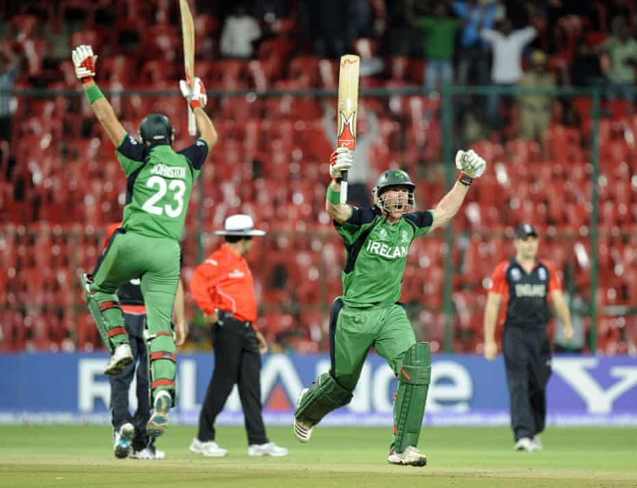 Ireland's John Mooney and Trent Johnston celebrate scoring the winning runs to defeat England by three wickets at the 2011 Cricket World Cup match in Bangalore, India.