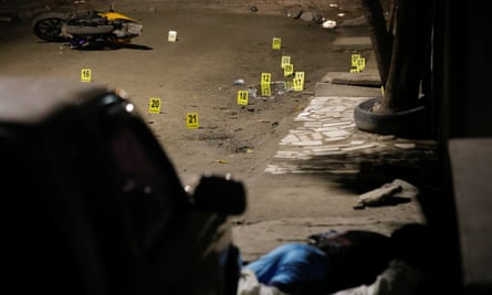A man lies dead after a shooting in San Pedro Sula, Honduras, on 2 June 2018.