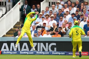 Glenn Maxwell of Australia leaps to catch the ball before throwing to captain Aaron Finch to dismiss Chris Woakes of England.