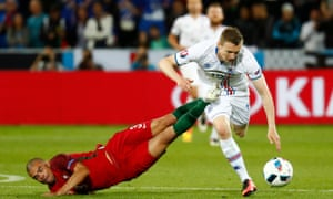 Iceland's goal-averse forward, Jon Dadi Bodvarsson, shrugs off a routine Pepe challenge.