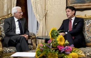 Italian prime minister, Giuseppe Conte, right,handing in his resignation to president Sergio Mattarella at the Quirinale presidential palace in Rome last night
