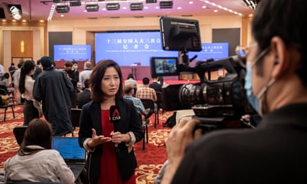 A TV journalist at a press conference in China