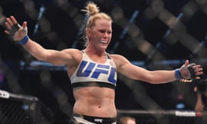 Holly Holm (blue gloves) celebrates after defeating Ronda Rousey (not pictured) during UFC 193 in Melbourne, 2015.