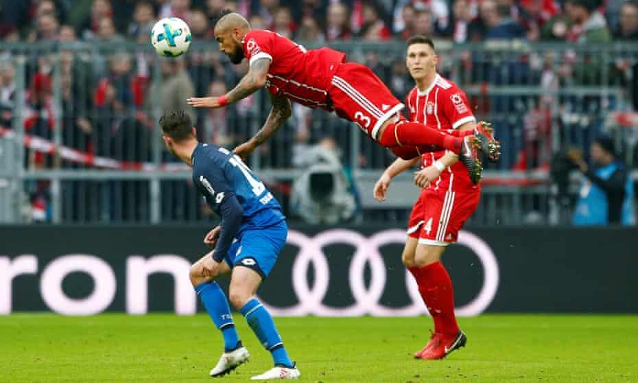 Bayern Munich's Arturo Vidal challenges for the ball.