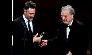 British director William Oldroyd (left) receives the discovery prize from director Stephen Frears
