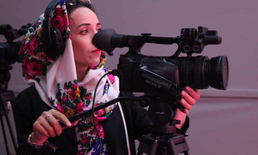 A camerawomen films footage for a Zan TV show.