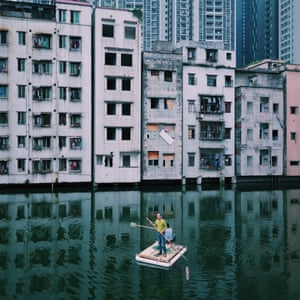 Shortlisted: Yuyang Liu. Two men were fishing in the pond of Xian village, in the centre of Guangzhou city, Guangdong, China, , which epitomises China's modern urbanisation.