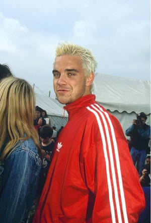 A 1995 moment: the newly blonde, tracksuited Robbie Williams about to embark on a new career. He left Take That in July.
