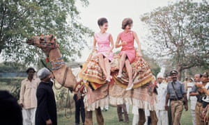 Jacqueline Kennedy, right, perches on camel with her sister, Lee Radziwill, in Karachi in March 1962.