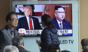 North Korean leader Kim Jong Un, right, and US President Donald Trump during a news program at the Seoul Railway Station