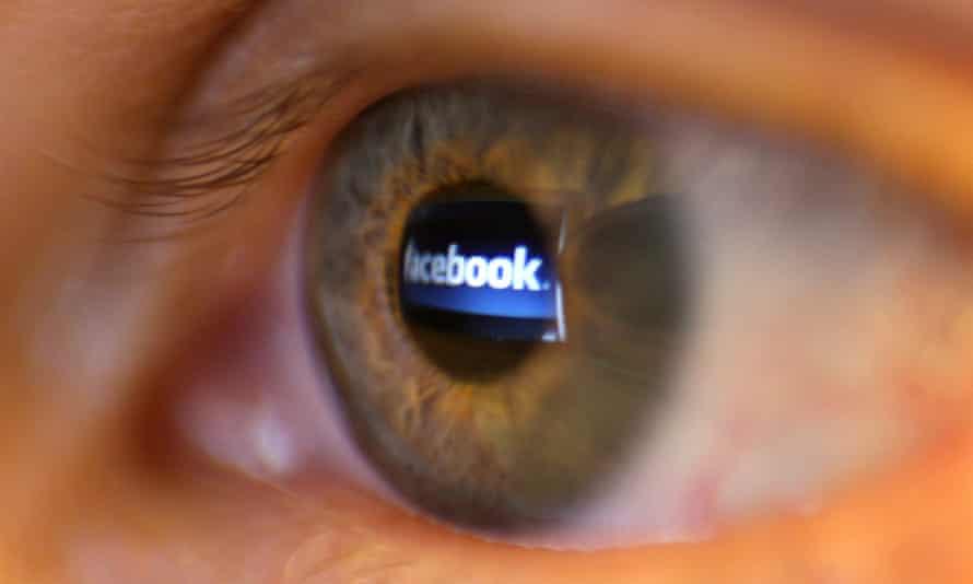 The Facebook logo reflected in a human eye