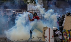Opposition protesters clash with Venezuela security forces in Caracas on Saturday.