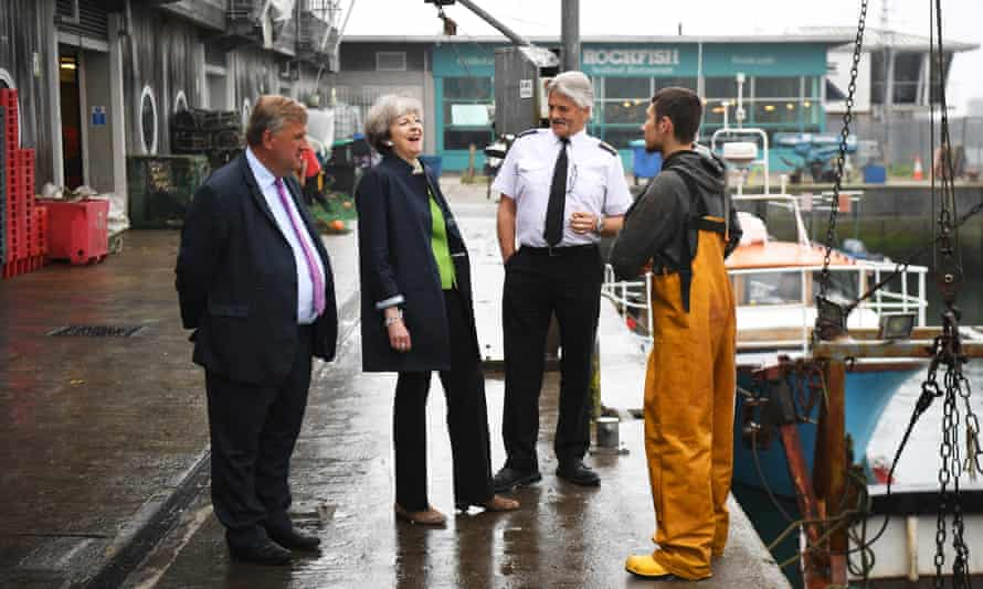 Theresa May is amused as she visits Plymouth fisheries on Wednesday.