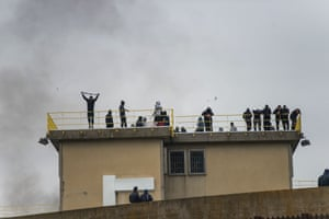 Inmates on the prison roof during a riot over coronavirus at Dozza Prison in Bologna
