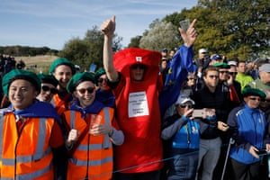 Fans dressed up as a postbox and postmen
