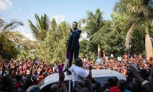 Bobi Wine addresses a crowd outside his home in Kampala on Thursday.