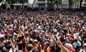 A crowd of opposition supporters listen to Juan Guaidó at Bolivar Square in Chacao, eastern Caracas, on Friday.