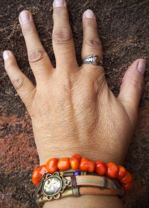 Karen Wyld's hand on a rock