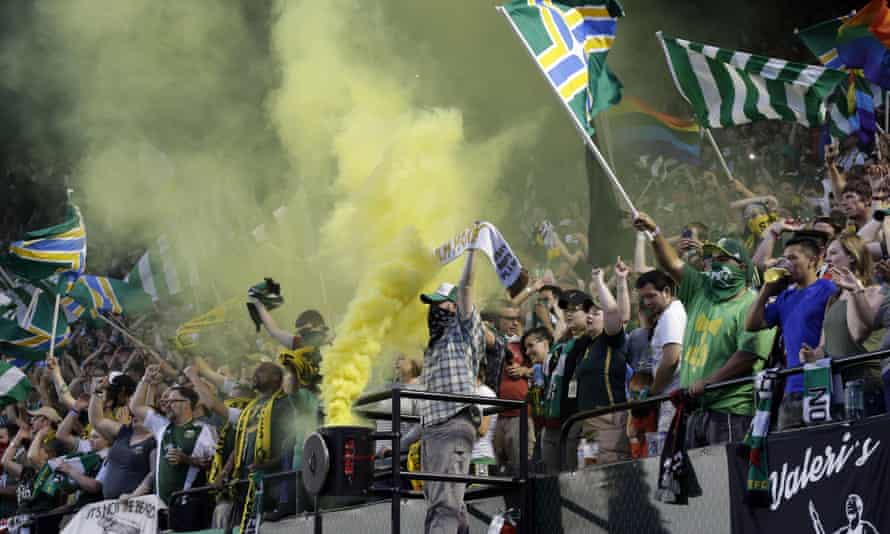 Portland Timbers fans celebrate after a goal during the second half of their game against Houston.