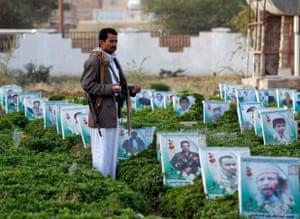 Yemeni man in graveyard with rifle