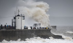 Waves crash against the harbour wall in Porthcawl