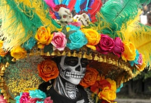 A person takes part in the Day of the Dead parade in Mexico City