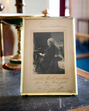 A framed card from Queen Victoria was placed nearby.