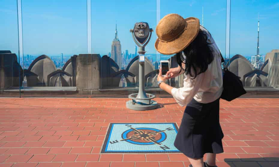 young woman taking a photo of the Rockefeller Center Observation Deck