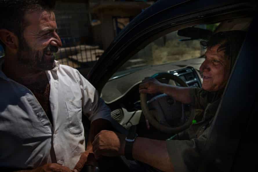 Farmer Mahmoud Ahmed, right, greets landmine deminer Hoshyar Ali at Hoshyari Village, Iraqi Kurdistan