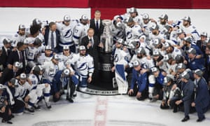 Tampa Bay Lightning players surround NHL commissioner Gary Bettman after winning the Stanley Cup