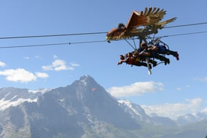"""The magnificent scenery of Switzerland's Bernese Oberland is usually enough on its own to set pulses racing, with the mighty Eiger, Mönch and Jungfrau peaks as a backdrop. But adrenalin junkies can now up the ante with First Glider, a new zipline ride that reaches speeds of up to 83km an hour. Thrillseekers are strapped into harnesses beneath an eagle-shaped """"glider"""" at the top of 2,166-metre Grindelwald First, and soar 800 metres to Schreckfeld. The flights cost £23 for adults and £17.50 for 10-15 years.  • jungfrau.ch Photograph: Simon Vogt"""