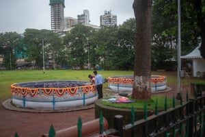 Statues are immersed in artificial ponds at August Kranti Maidan, Mumbai, 23 August.
