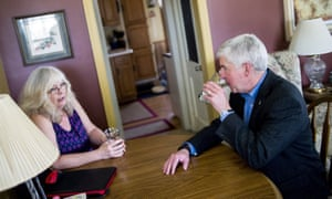 Rick Snyder, right, drinks filtered Flint, Michigan, tap water with Flint resident Cheryl Hill.