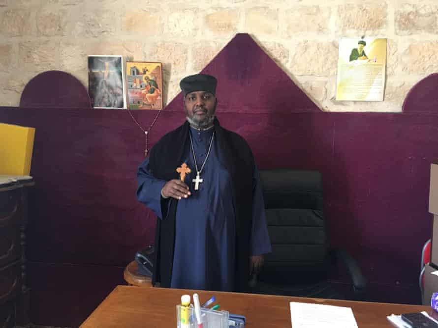 Aba Zebeaman Samuel, who manages the Ethiopian Orthodox church and monastery.