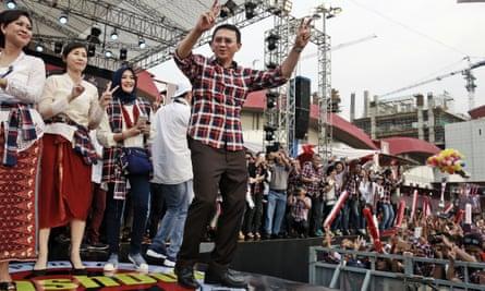 Jakarta governor Basuki 'Ahok' Tjahaja Purnama, dances during a campaign rally in Jakarta.