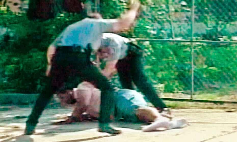 Two white Oklahoma City officers subdue a black suspect in 2002. Both officers faced a disciplinary investigation.