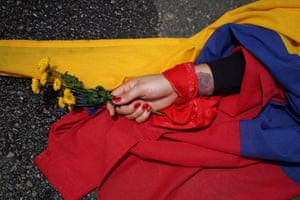 A demonstrator holding flowers in Bogotá