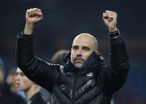 Guardiola celebrates his teams 4-1 win.