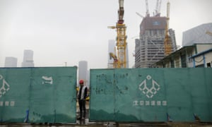 A worker at a construction site in the centre of Beijing. Investors were encouraged by Friday's interest rate cut.