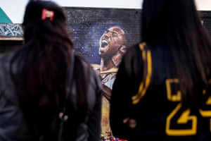Fans gather to mourn at a mural near the Staples Center in Los Angeles, California.