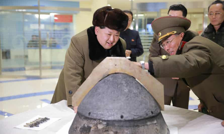 North Korean leader Kim Jong-un inspects a section of a ballistic missile warhead.