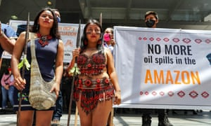 The Kichwa, indigenous people of the Amazon, fight police harassment when protesting oil spills outside the Council of the Judiciary in Quito earlier this month.